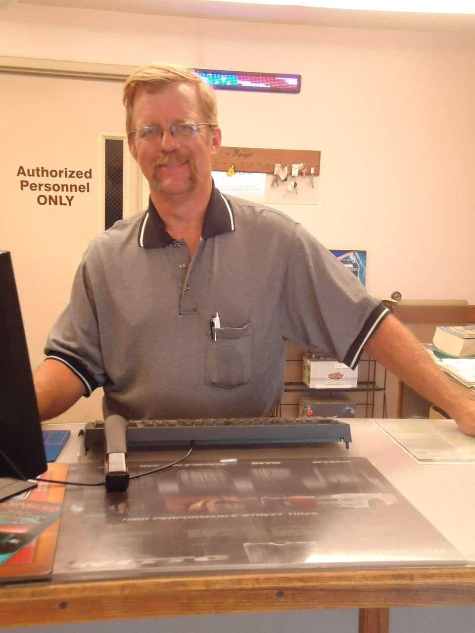 gary starkey at front desk area of gary's auto shop, grand island, ne